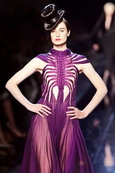 """And then there was Jean Paul Gaultier's version of Schiaparelli's skeleton dress for his fall 2006 collection, which he titled """"Les Surréalistes."""" The topper? A chapeau that appeared to be made from the model's own hair.   - ELLE.com"""