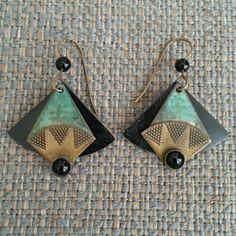 Drop Earrings! One of a kind Stylistic Earrings. Will catch lots of compliments!  The earring has movement, the front piece is separate from the black background. Beautiful! Jewelry Earrings