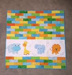 Jungle Animal #Baby #Quilt by QuiltinCin on Etsy https://www.etsy.com/listing/210890605/jungle-animal-baby-quilt?ref=teams_post&utm_content=buffer0766e&utm_medium=social&utm_source=pinterest.com&utm_campaign=buffer #handmade #qqqetsy #nursery
