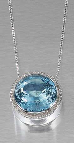 AQUAMARINE & DIAMOND PENDANT NECKLACE.  The pendant centring on a circular-cut aquamarine within a surround of single-cut diamonds, to a trace link chain, length approximately 510mm