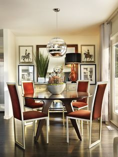 Dining area set up - buffet table along the wall, mirror, round dining table in front of sliding deck door