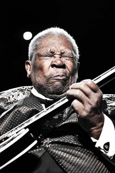 BB King  by Jerome Brunet I can almost hear the note screaming and torquing out...great shot for this subject.  The only thing is the spotlight near his head... Live shots are hard to get the way you need them....I'd be tempted to use edit to slightly darken the spotlight.