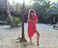 Beach vibes: Actress and model Phoebe Tonkin looks gorgeous in a floaty red dress on a sec...