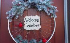 "A Welcoming Bicycle Rim Winter Wreath After you see this gorgeous Christmas ""tree"", you'll never want to get anything else! Front Door Christmas Decorations, Christmas Wreaths, Christmas Crafts, Winter Wreaths, Christmas Tree, Beautiful Front Doors, Bicycle Rims, Diy Wreath, Wreath Crafts"