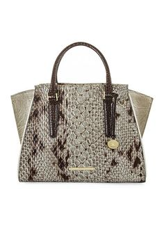 This superb satchel offers chic style with a cutting-edge snake print design you'll love to showcase. Make a trend-savvy statement while carrying all of your essentials in this stunning handbag.