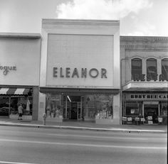 The Eleanor retail store on Monroe Street between College and Park avenues in Tallahassee. The Vogue is partially visible on the left and the Busy Bee Cafe restaurant is partially visible at the right (1959). | Florida Memory