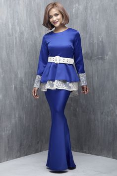 EMEL X SAZZY FALAK - ROYAL STAR - Modern Peplum with Textured Lace (Blue) This peplum design is simple yet sophisticated, featuring textured lace on the peplum and sleeves as well as on the belt for a demure and feminine look. Adjustable belt included with purchase (removable). #emelxCLPTS #emelxSazzyFalak #emelbymelindalooi #bajuraya #bajukurung #emel2016 #raya2016 #SazzyFalak #peplum #lace #blue #moden #2016 #baju #kurung #baju #raya
