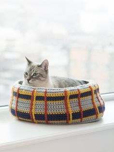 Crochet a Curl Up Kitty Cat Bed for your feline friend! Your cat will love having a cozy place to sleep, and you can make it in colors that complement your decor! Pattern calls for 11 balls of Hometown USA and a size J-10 (6 mm) crochet hook.