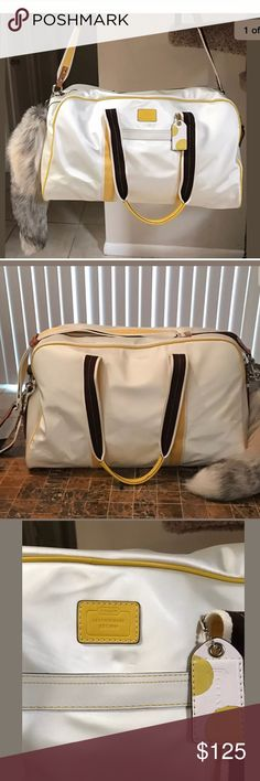 """Large Coach weekender Travel Bag. Awesome🦋🦋 Beautiful Large Coach weekender travel bag in heavy Satin Nylon washable surface, yellow leather piping and trim. This bag is in excellent condition with little use, # L0668-10668. It measures 21"""" by 13"""" and 10"""" deep.   *The shoulder strap is removable measuring 48"""" and handles have a 12"""" drop measuring ttl about 25"""" w a top heavy zipper closure.  *The interior is very roomy with compartments and the bottom of the bag is footed as well.  *please…"""