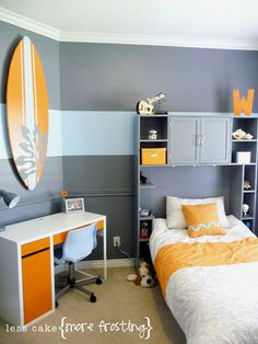 Split Complementary Color Scheme: The orange with baby blue and a navy blue in this room make it a split complementary color scheme. These colors give the room a non energetic feeling.