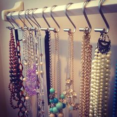 hang necklaces from shower hooks?