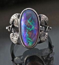 BERNARD INSTONE 1891-1987 Attrib. Arts & Crafts Ring / Silver, Suberb Australian Butterfly Wing opal / British, c.1925