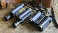 """""""First english prism binoculars produced"""".  Left, Ross 10X21 in collection. Serial number 1145. Year 1899 - 1900 First serie count 3000 pieces of 6X-8X-10X-12X, If and Cf. The unique """"arms"""" are the John Henry BARTON Patent, descibed On 13 December 1898 ;  """"A design for a binocular telescope where the two bodies carrying the lenses and prisms are mounted between two bars. The bodies rotate about the axes of the objectives. The amount of rotation ( to obtain the correct interpupillary distance…"""