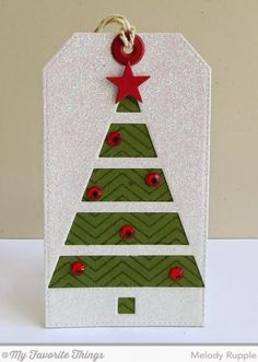 The tree is cut with this month's free with $60, the Christmas Tree Cut Out Die-namics. The background on the tree is stamped with the  Fine Chevron Background Stamp and I added some red gems from my stash.   http://apapermelody.blogspot.com/2014/10/mfts-october-new-product-launch.html  Melody