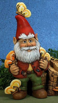 Meet Flutter, a more of a traditional garden gnome who can be found sitting on a log or stump playing with all his butterfly friends.