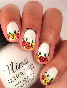 Glossy version of this simple girly flower nail art using Nina Ultra Pro nail polish and acrylic paint! Instagram: @ilovemymani