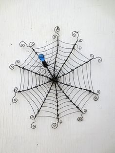 "24""  Barbed Wire Spiderweb With Blue Glass Spider Upcycled Art Made To Order. $77.00, via Etsy."