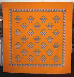 1800's quilt from Lancaster County, Pa. For the serrrrrrrrrious Cheddar lover!!!! No size given. Alot of heart shaped stitching. Pink is a delicate floral. Cerilian blue (denim like)!! A whole lot of Cadmium orange!!