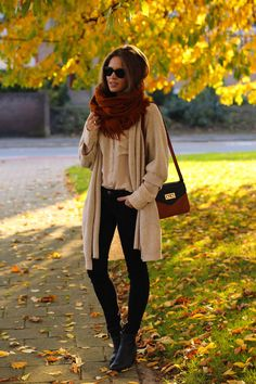Dark red scarf, creme cardigan, black pants, and black boots. Perfect fall weather outfit.