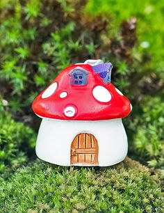 """The Mini Mushroom Home terrarium accessory helps imbue your fairy garden terrarium with life.  Accessories serve to animate your terrarium.  They inspire wonder and bring a smile to all who behold them.  Works well with air plants, succulents, cacti, moss, lichen and ferns.•Approximate size- (1¾""""x 1¾""""x 2"""").•Color chosen will be by randomized selection.•CONTAINS NO PLANTS, SOIL OR ROCKS.  (Product for sale is just the home)."""