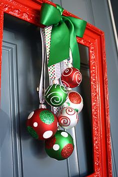 Cute wreath alternative Painted frame with Painted Christmas balls hung with ribbon from it.