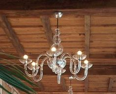 """DANIELI L6 SUSPENSION - <p style=""""text-align: justify;""""> This classic chandelier is an example of true craftmanship. Intricate yet sleek glasswork comprises the unique frame of the Danieli chandelier from the central metal and hand made glass bowl, cleanly curving arms culminate bowl-shaped light holders. Available in crystal glass with polished chrome structure. Companion wall sconce as well as a large size chandelier also available.</p>"""