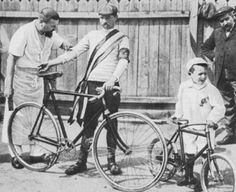 1903 Tour winner Maurice Garin having a smoke. Pictured with him are his son (on right with little bike) and his masseur.