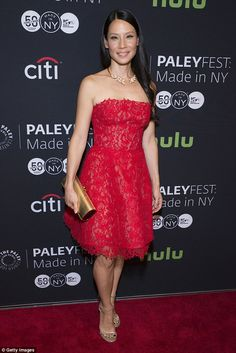 Bold and beautiful: Lucy Liu looked ravishing in red as she stepped out to promote Element...