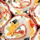 Party Pinwheels....Made with flour tortillas, cream cheese, dry ranch dressing, cheese and whatever you can think of to put in the filling...Would be easy for get-togthers
