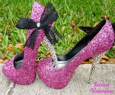 Pink sparkly heels with a black bow