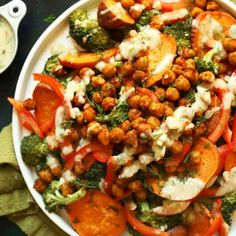 A satisfying plant-rich entrée or side with roasted broccoli, sweet potato + chickpeas. W/ a creamy 4-ingredient garlic dill sauce.