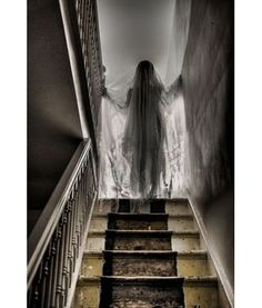 Gauze draped mannequin in the stairwell for a truly ghoulish accessory to a Halloween party.