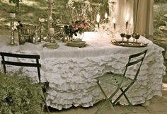 Courtney at the blog French Country Cottage was my inspiration for this.   A bed skirt I bought to use as a tablecloth