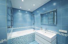 A contemporary bathroom fully clad with bright blue tiles looks bold and raises your mood Bathroom Spotlights, Led Bathroom Lights, Bathroom Lighting, Blue Bathrooms Designs, Bathroom Tile Designs, Bathroom Design Small, White Bathrooms, Bathroom Ideas, Modern Luxury Bathroom