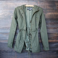 Womens hooded utility parka jacket with drawstring waist in olive green