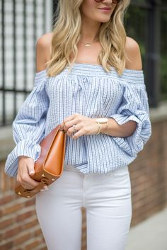 Blue off shoulder top and white skinny jeans