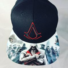 The best Assassins may be after you with this one of one special custom. You are sure to be the talk of towns you travel with gamers everywhere awestruck by your extremely rare never to be seen anywhere else custom Creed modified brim.    This cap was made to be a single edition piece. The only one in the world.  Exclusivly engineered by Tatts4Hats creator. You will receive a Certificate of Authenticity and ownership rights to the image created on the bill.   -Authentic Brand Canvas    -100%…