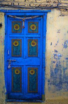Bright Blue Door with Decorative Sunflowers in Dhobi Ghat, Mumbai, India Cool Doors, Unique Doors, The Doors, Windows And Doors, Porte Cochere, When One Door Closes, Knobs And Knockers, Door Gate, Door Opener