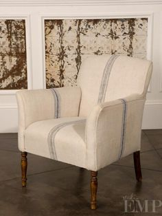 love  this chair and the old tin in the wall panels greaat idea !