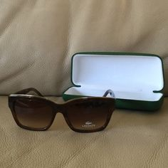 Lacoste sunglasses Super fashionable sunglasses. Brown frame has a golden decorative upper front. Lacoste Accessories Sunglasses