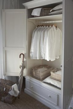 Gorgeous Closet inside a beautiful Armoire.