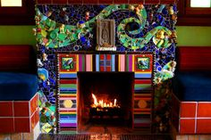 "Fantastic!  By mosaic artists Beserra-Byrd.  ""We built the fireplace as our portrait,"" adds Beserra, who in 1997 bought the three-bedroom Silver Lake home with Byrd, his partner of 28 years."