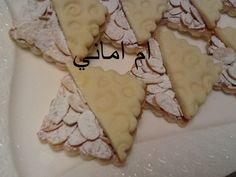 صابلي وحدة ونصف برقائق اللوز للأخت ام اماني الطريقة بالصور في هذا الرابط: http://www.halawiyat-malika.com/2014/05/blog-post_5925.html