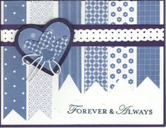 handmade card ... blues and white with a bit of black matting... collection of blue washi tapis hanging down with fishtail ends .. hear on top ... sweet look ...