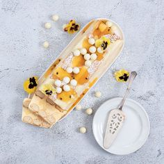 This festive dessert is creamy like ice cream but layered with fruit and biscuits like trifle. Custard Powder, South African Recipes, Vanilla Custard, Edible Flowers, Trifle, Rhodes, White Chocolate, Delicious Desserts, Pear