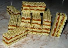 ngredients for caramel cream: - 350 g of sugar - 4 yolks - 200 g of butte Romanian Desserts, Romanian Food, Serbian Recipes, Romanian Recipes, Waffle Cake, Kolaci I Torte, Good Food, Yummy Food, Homemade Cakes