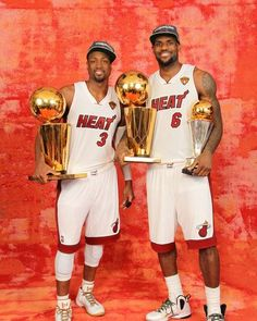 Dwyane Wade and LeBron James of the Miami Heat poses for a portrait with both Larry O'Brien Trophies and the Bill Russell Finals MVP Trophy after winning the Championship - http://www.fansedge.com/Dwyane-Wade-LeBron-James-Miami-Heat-NBA-Finals-Game-5-6212012-_389127384_PD.html?social=pinterest_nbafinals_wadelbj