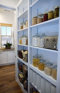 shallow shelves in the laundry room for extra pantry storage?
