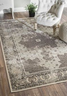 This is the rug I'm thinking of getting to replace the one in my living room. I love the color, and that it's styled like a traditional oriental rug, but with a more modern flair. Beaumont Adileh VI15 Grey Rug #RugsUSA