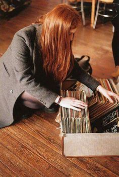 Lily going through My records to find The Beatles, Taken by Sirius Black